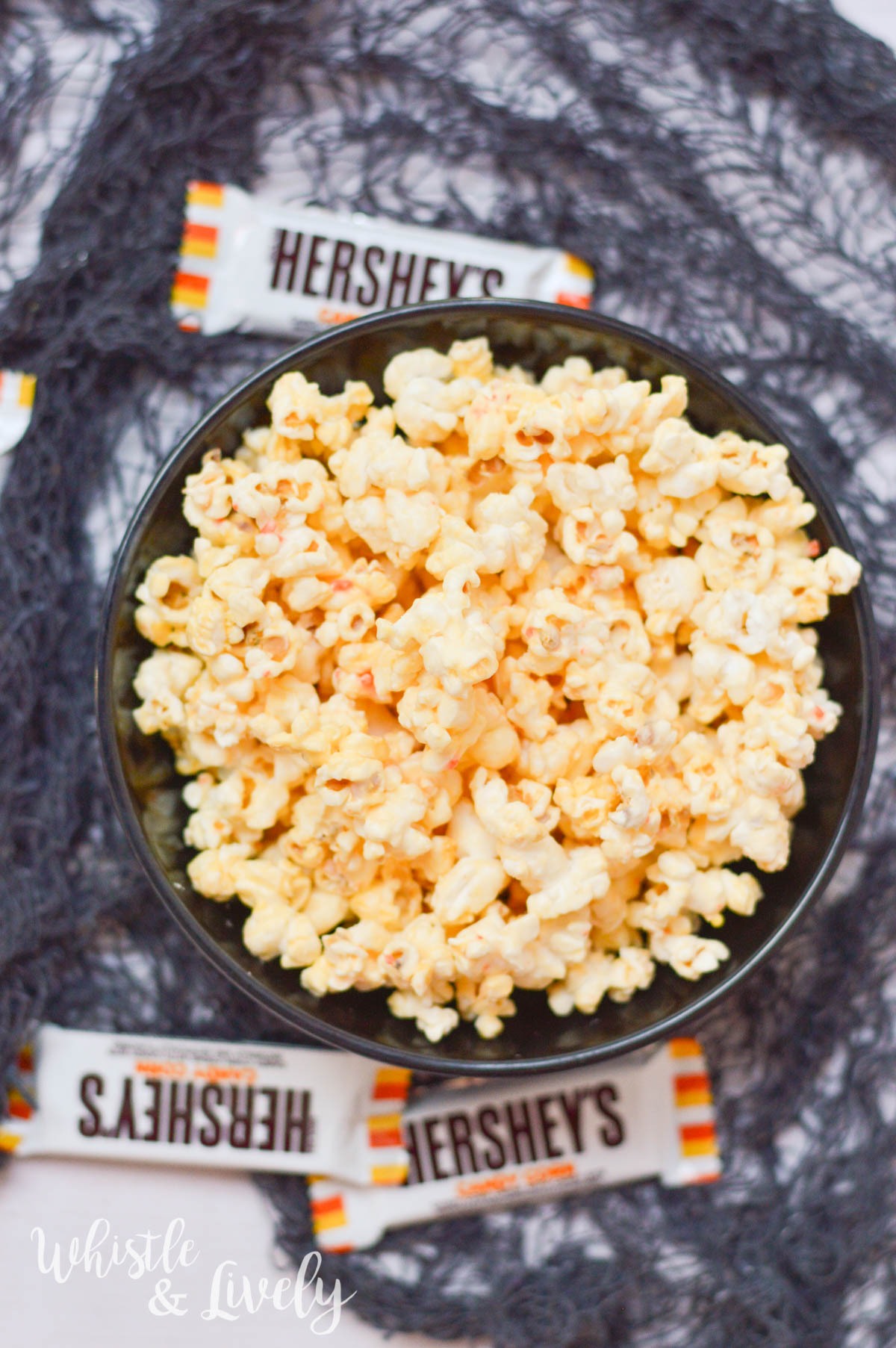 White Chocolate Candy Corn Popcorn - The perfect balance of sweet and salty, this candy corn popcorn is sure to please even those who don't love candy corn.