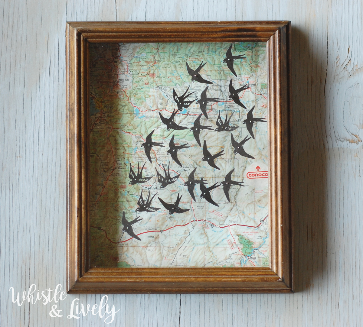 Map and Swallows Shadowbox - Transform a shadowbox into this pretty room decor. With just a few supplies you can make this pretty map wall hanging.