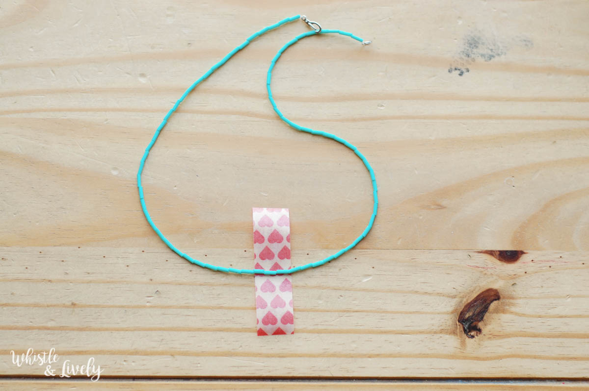 Easy DIY - Washi Tape Necklace | Make this cute, trendy washi tape necklace with a few supplies and in just a few minutes! So many colors to choose from and a perfect craft for kids.